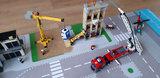 LEGO set Brand op de bouwplaats 60216 op een speelmat